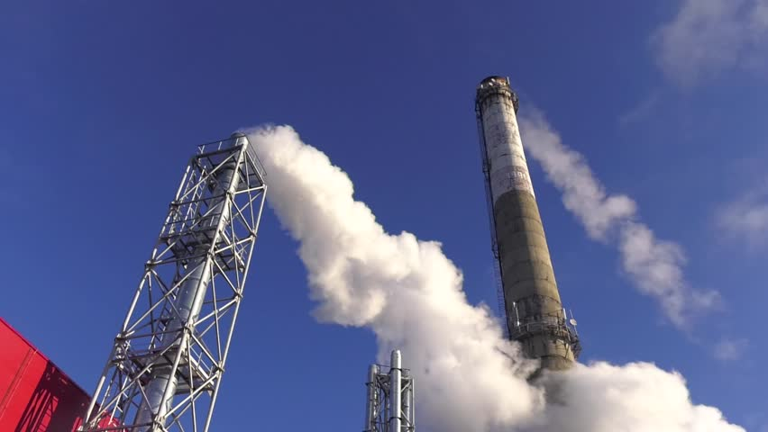 Industrial plant exhausting white smoke into the atmosphere. Reset steam into the atmosphere. Smoke from the pipes of heat station during the extremely low temperatures   | Shutterstock HD Video #1022244928