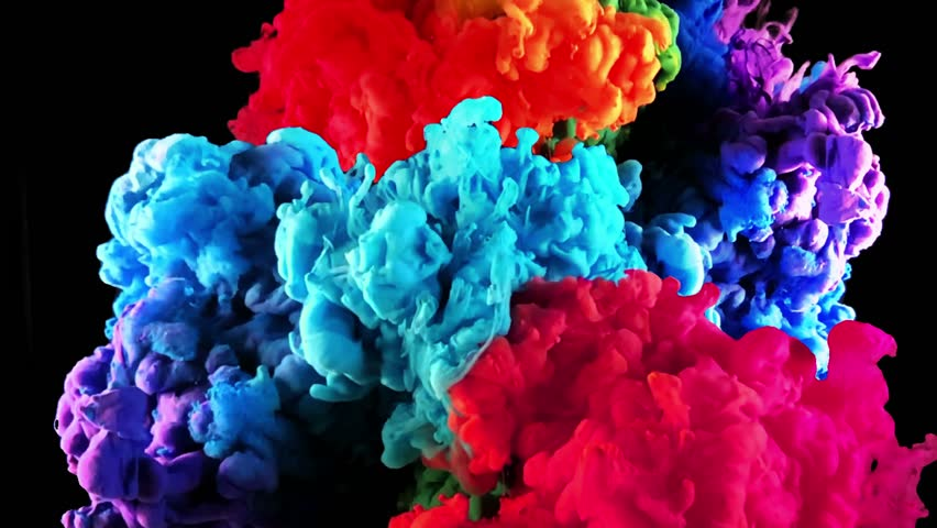 Color paint drops in water in slow motion. Abstarct colorful rainbow ink paint drops in the water. Slow motion of Liquid ink isolated on black background. Colored ink cloud mixing with alpha mask.