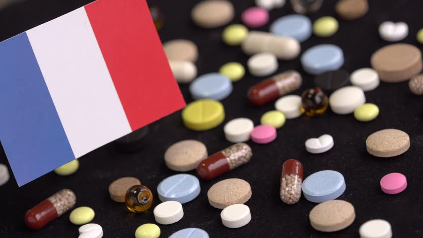 Medical pills and flag of France. Pharmacy Business | Shutterstock HD Video #1022295202