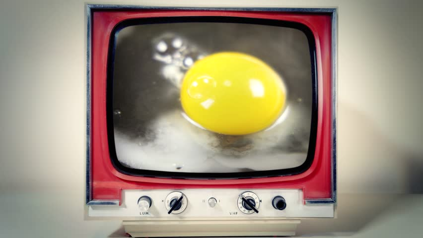 A retro vintage TV showing the process of cooking an egg in a pan. Detail shot.  | Shutterstock HD Video #1022301889