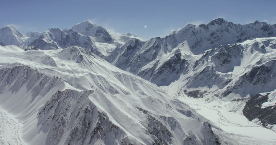 Himalayas wide shot POV AERIAL View near Mount Everest of snowcapped cold rock mountain in Nepal and Tibet