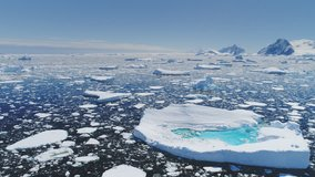 Antarctica Melting Blue Water Iceberg Aerial View. Antarctic Ocean Environment. Arctic Ice Nature Landscape of Global Warming and Climate Change Concept Top Drone Shot Footage 4K (UHD)