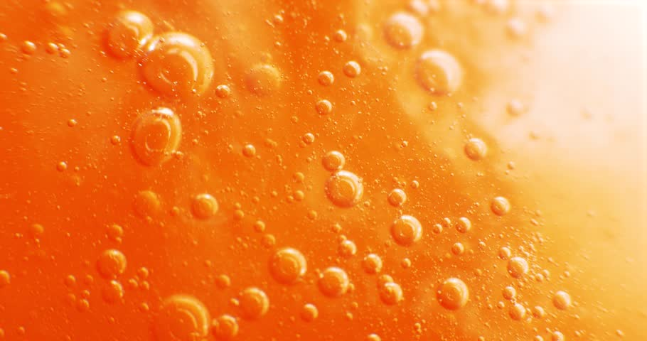 Extreme macro of bubbles in orange gel