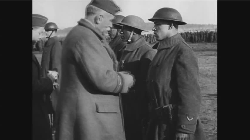 CIRCA 1940s - Black soldiers Needham Roberts and Henry Johnson receive medals for distinguished service during World War 1 in France.