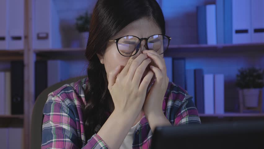 Slow motion of young female people massage nose bridge eyes hurting. college girl long time overtime studying looking staring at laptop screen shaking head painful eye. tired asian feel fatigue. | Shutterstock HD Video #1022457565