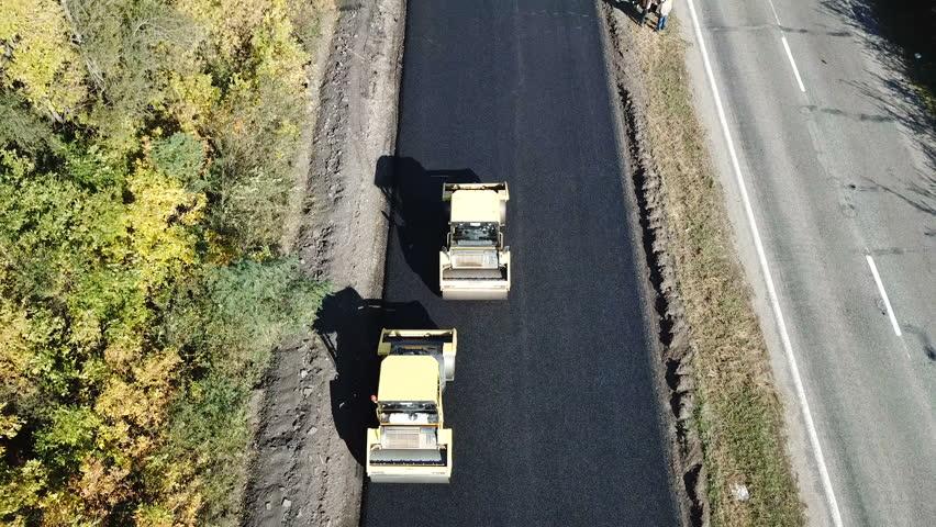 Ukraine, Dnipro - October 11, 2018: Repair pavement on the highw #1022470684