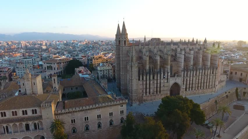Panoramic aerial drone view over the city of Palma de Mallorca, showing the large cathedral, busy highway, gardens, city skyline. A historic cultural Spanish city in Majorca. | Shutterstock HD Video #1022485702