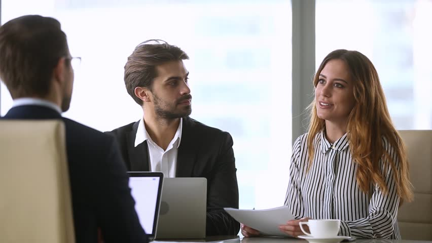 Businesswoman handshaking new male partner make deal finish group negotiation, satisfied executives conclude contract agreement shake hand thanking for successful teamwork, hr hiring at job interview Royalty-Free Stock Footage #1022497294