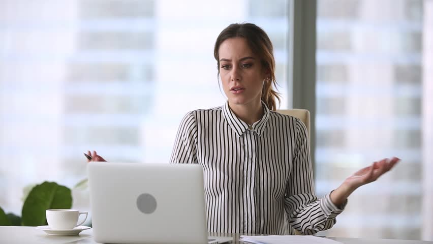 Annoyed stressed businesswoman mad about online problem, failed software application, laptop data loss or stuck computer virus slowing system working with notebook and papers leaving office workplace