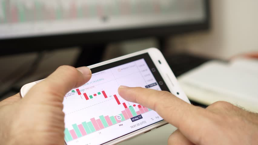 Businessman analyzes the data of the currency or stock exchange using the application on the smartphone. | Shutterstock HD Video #1022523601