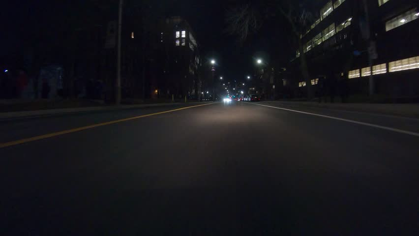Toronto, Ontario, Canada January 2019 Driving plate POV low angle dark city streets at night with car traffic #1022523649