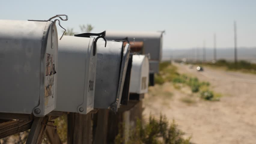 Row of mailboxes in American desert. Roads of Nevada and Arizona. Abandoned place near the road. Far away from cities.   Shutterstock HD Video #1022542489
