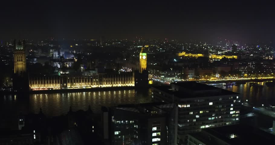 Aerial drone shot of the Big Ben London by night. This shot is made before the renovation started. Perfect for Brexit use.
