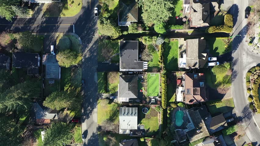 A perfect neighbourhood. Houses in suburb at Summer in the north America. Luxury houses with nice landscape. Aerial up down drone view. 4K. | Shutterstock HD Video #1022565508
