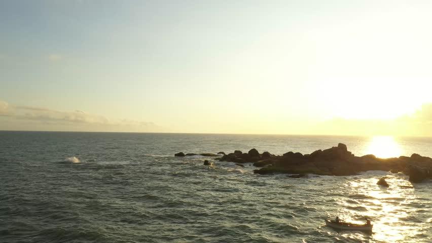 Beautiful aerial image of the fishing village in Praia do Cardoso. Fishermen from Laguna - Santa Catarina - Brazil. Cape of the Lighthouse of Santa Marta.  | Shutterstock HD Video #1022565928