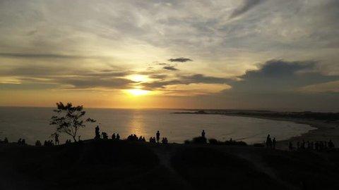 Several people enjoying the sunset. Sunset on the beach of Santa Marta Lighthouse - Brazil