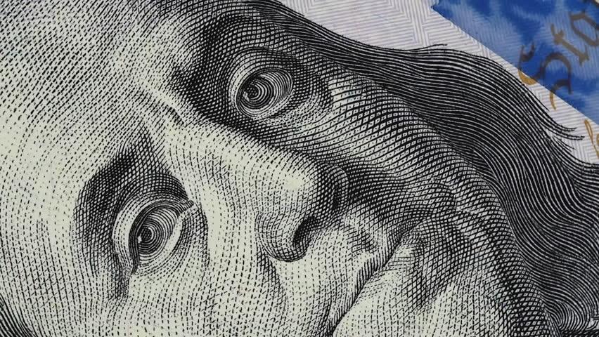 Benjamin Franklin on US 100 dollar bill slow rotating.  | Shutterstock HD Video #1022571136