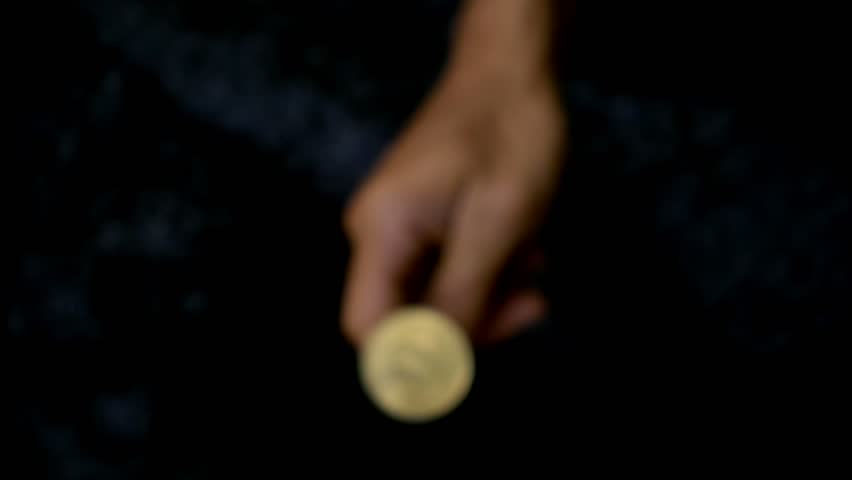 Slowmotion shot tossing bitcoin to flip on heads or tails | Shutterstock HD Video #1022579152