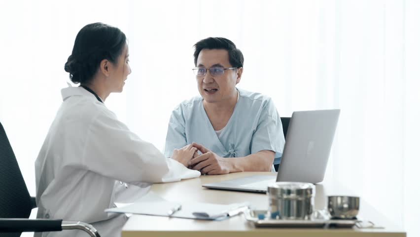 Doctor with patient. Young female medical doctor talking to a senior patient at hospital. Sharing medical test result via computer. Senior care medical and insurance concept. | Shutterstock HD Video #1022583412