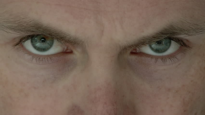 Close up of sinister looking eyes looking deep into your soul.   Shutterstock HD Video #10225979