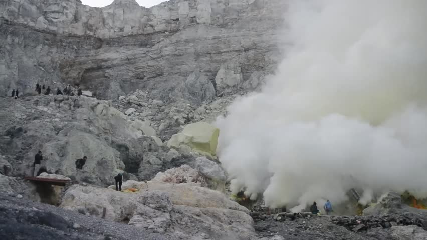View of Mount Ijen, sulfur search workers who are mining sulfur, in Ijen crater. Indonesia | Shutterstock HD Video #1022620660