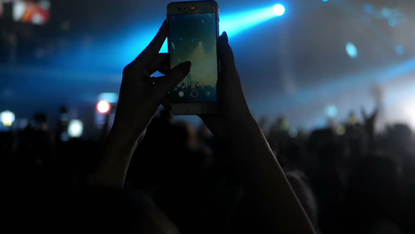 Girl and boy at a concert seating on shoulders dance | Shutterstock HD Video #1022626534