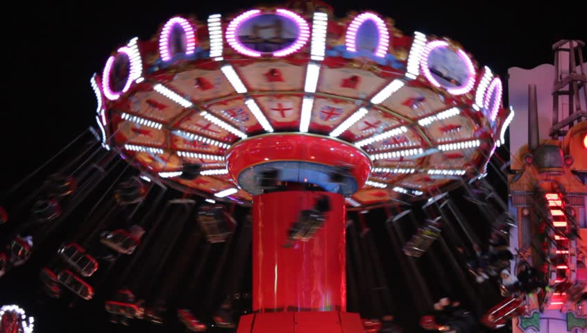 swing fairground funfair ride at night. swing fairground funfair ride carousel merry-go-round swings seats moving Chair-O-Planes or swinger with filter stock stock, footage, video, clip Royalty-Free Stock Footage #1022628553