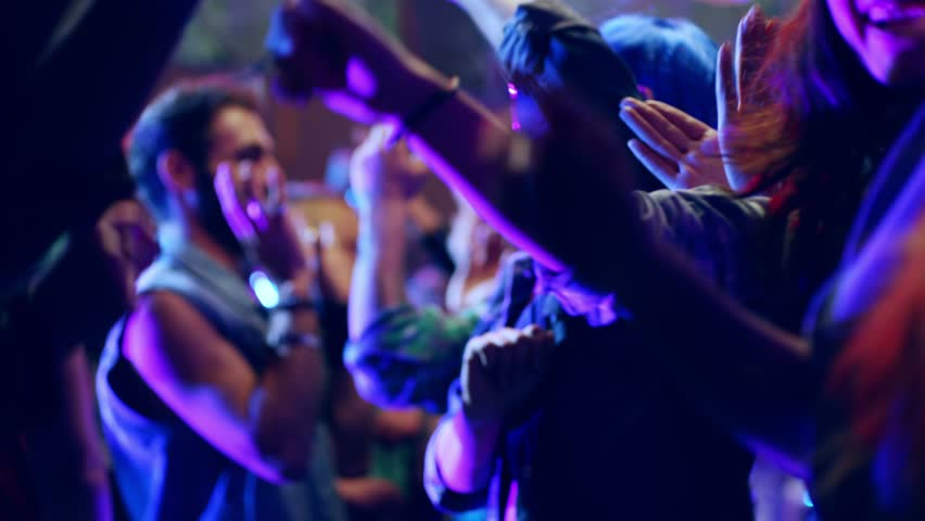 Footage of a crowd or group of young, stylish multi-ethnic people during colorful party in different clothes . Dancers having fun dancing at a party . Shot on RED HELIUM Cinema Camera in slow motion .   Shutterstock HD Video #1022655544