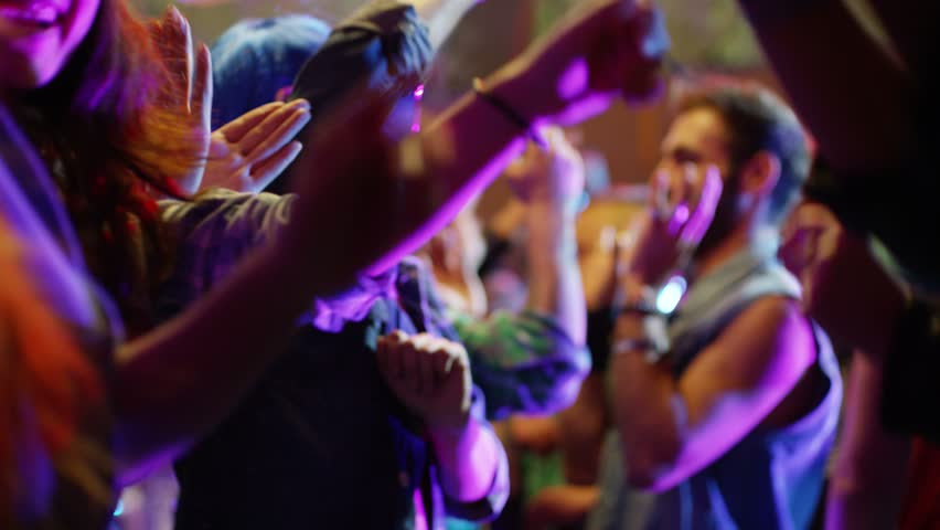 Footage of a crowd or group of young, stylish multi-ethnic people during colorful party in different clothes . Dancers having fun dancing at a party . Shot on RED HELIUM Cinema Camera in slow motion . | Shutterstock HD Video #1022655559