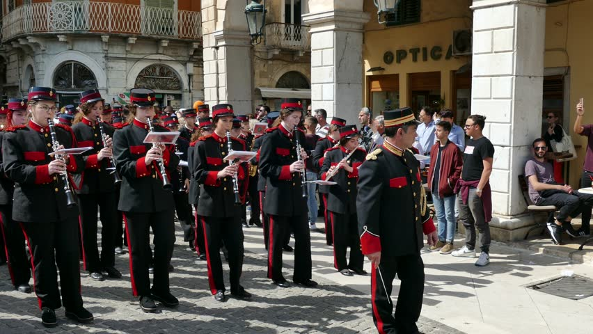 CORFU, GREECE - APRIL 6, 2018: Philharmonic musicians playing during Corfu Easter holiday celebrations. Corfu has a great tradition in music, with 15 philharmonic bands.