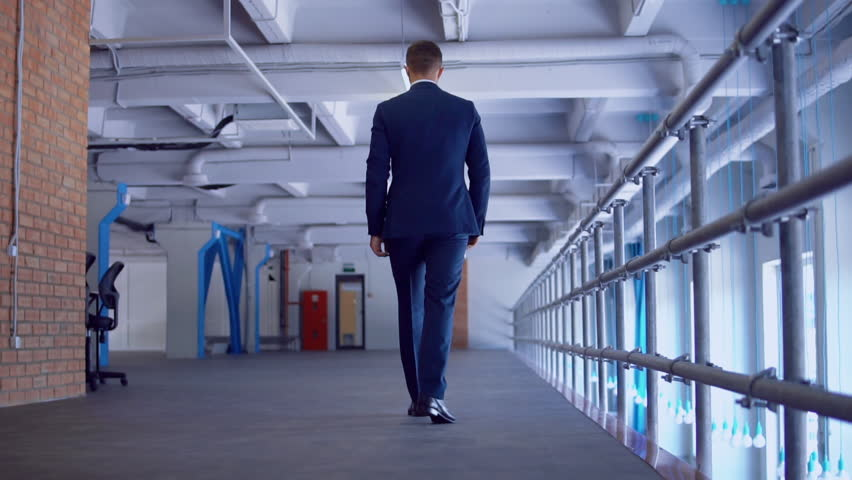 unrecognizable worker moving on the second floor in storage. elegant manager wearing formal blue suit slow motion #1022711146