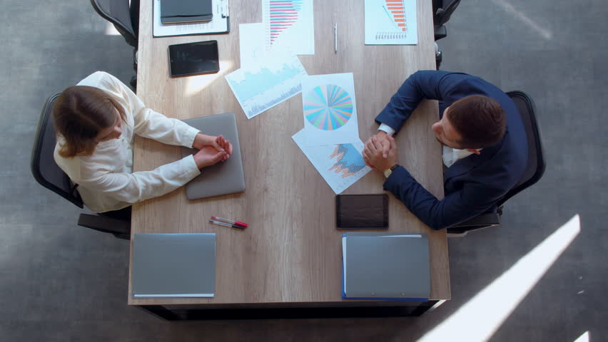 top view businessman and businesswoman finish negotiations shake hands and leave the boardroom. Royalty-Free Stock Footage #1022711191