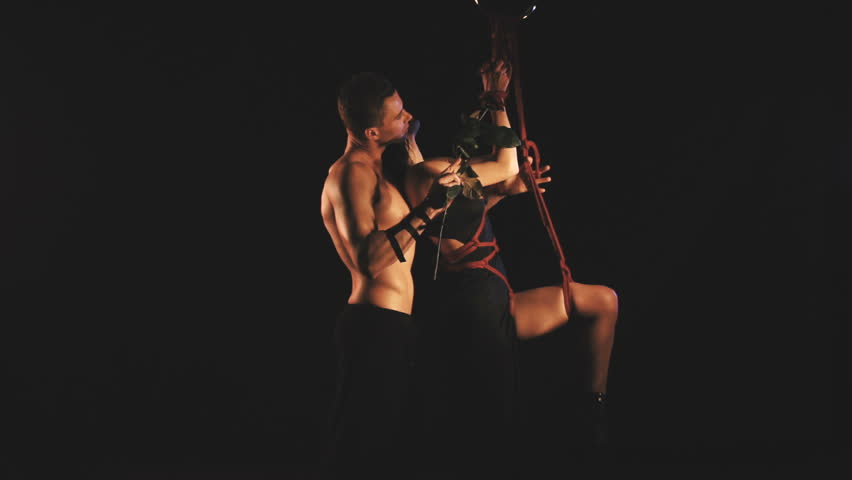 A couple in a intimal moment. Man and woman. Bdsm theme