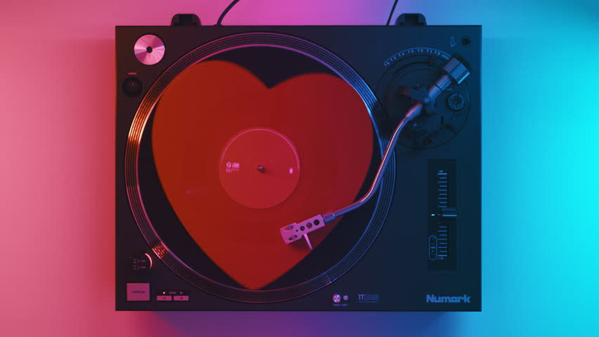 Varna, Bulgaria January 2019 turntable Numark: red heart Vinyl Retro Record white table with plates. Stylus with needle. Red blue light. Loop. Valentine's Day. Popular Disco Trends 70s, 80s, 90s