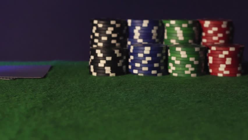 Poker chips fall on the green table | Shutterstock HD Video #1022745223