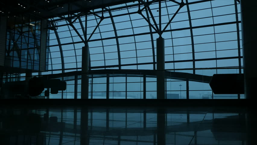 Silhouette of an adult man walking with a bag at the airport   Shutterstock HD Video #1022760076