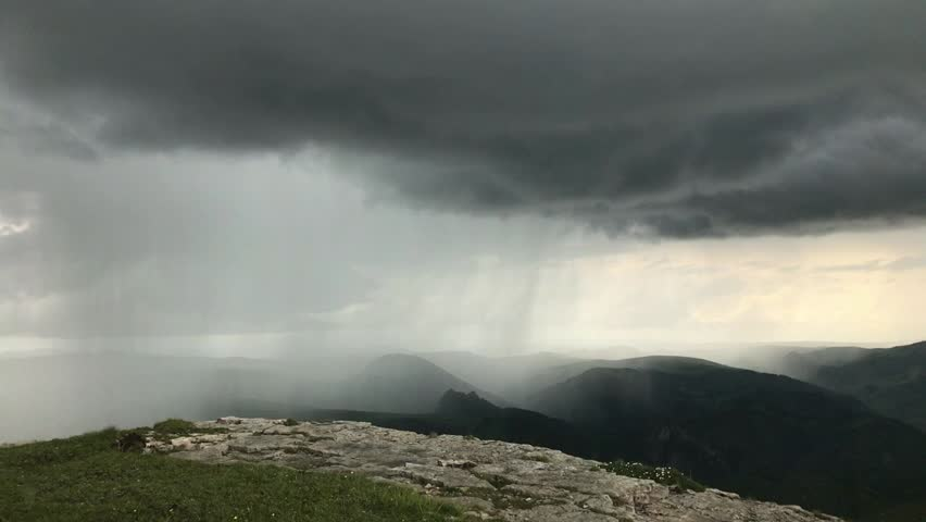 Thunderstorm, rainfall and lightnings in Caucasus mountains. Timelapse with flowing and transformation of dark low clouds on a summer day. View from Bermamyt plateau, Karachay-Cherkessia, Russia | Shutterstock HD Video #1022761189