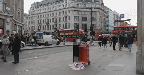 LONDON ENGLAND - JANUARY 2019 - Oxford street main high street shops people walking travelling red bus driving