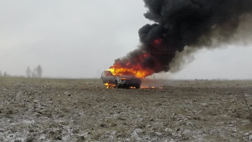 Car On Fire, Burning Car In The Field