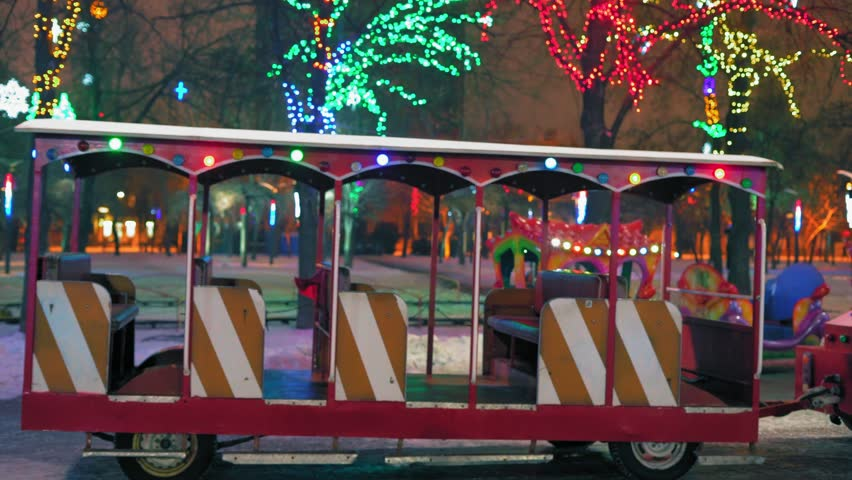 Colored Holiday Lights on the Children's Train at Night Park | Shutterstock HD Video #1022773615