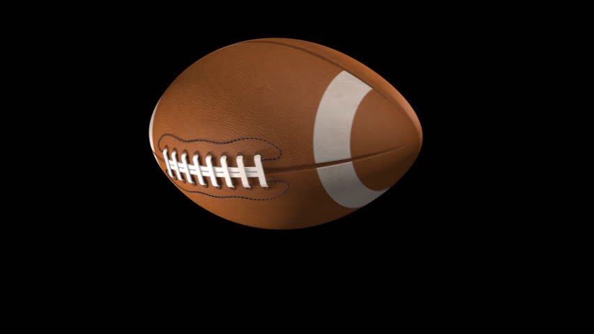 Slow Motion American Football Spiraling Towards Camera Over Black Background.  3D Animation