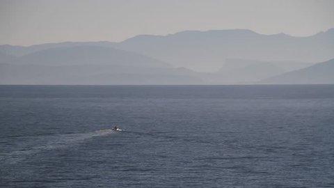 View of  Corfu (Kerkyra). Kerkyra - capital of Corfu island, Greece. Panagia Vlacherna and the island of Pontikonissi (mouse island) near Kanoni, Corfu