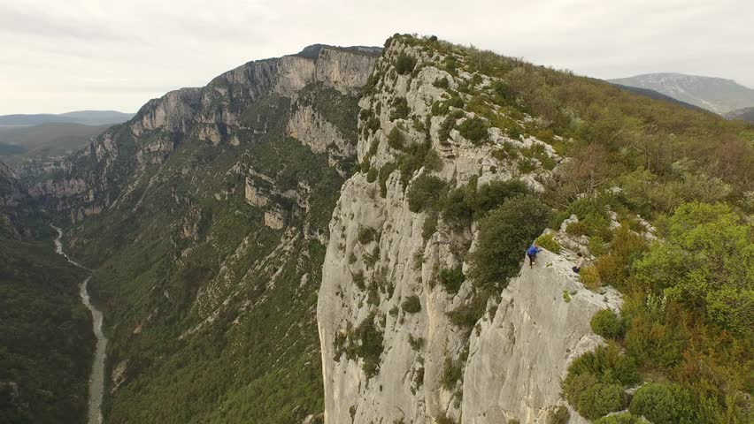 Aerial view by drone of a man climbing in free solo, without safety material, a very high cliff in Verdon, France | Shutterstock HD Video #1022819512