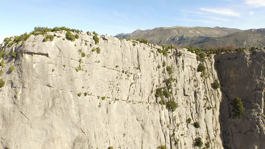 Aerial view by drone of a man climbing in free solo, without safety material, a very high cliff in Verdon, France | Shutterstock HD Video #1022819524