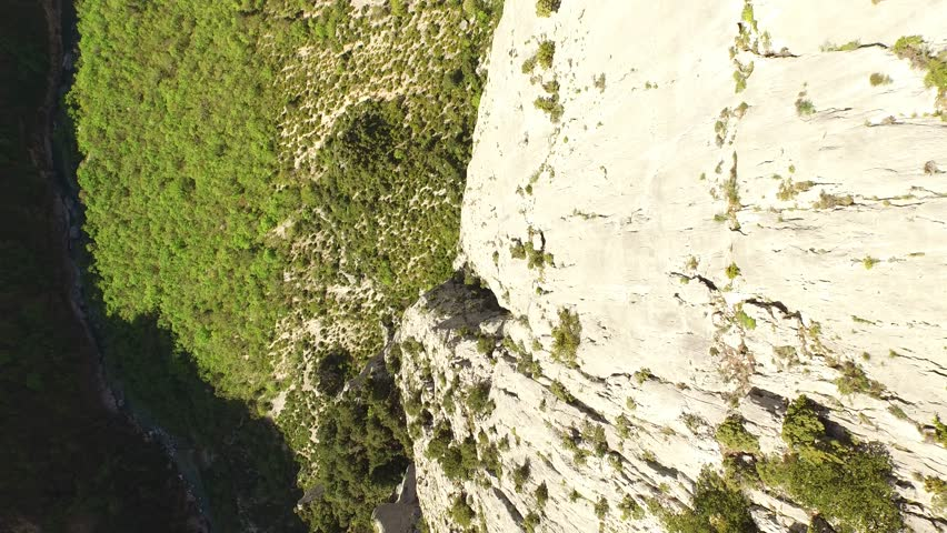 Aerial view by drone of a man climbing in free solo, without safety material, a very high cliff in Verdon, France   Shutterstock HD Video #1022819527