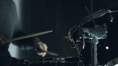 Jazz drummer playing at drums set on concert isolated on black background. 4k. Medium shot.