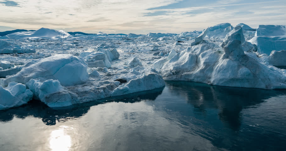 Drone video of Iceberg and ice from glacier in arctic nature landscape on Greenland. Aerial video drone photo of icebergs in Ilulissat icefjord. Affected by climate change and global warming.   Shutterstock HD Video #1022844982