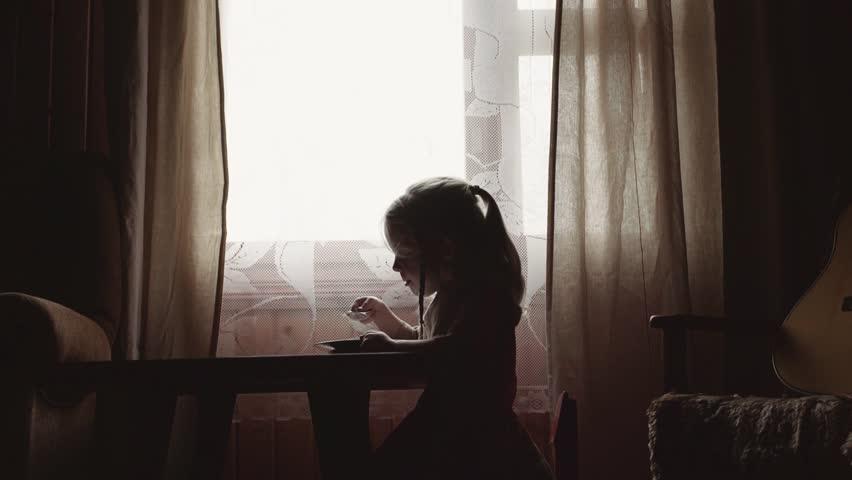 Little blonde girl eat porridge | Shutterstock HD Video #1022859811
