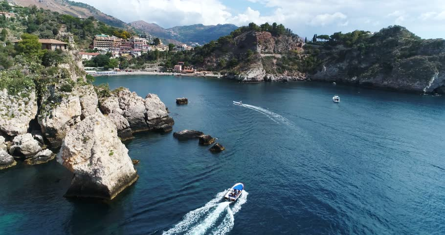 Panoramic aerial view of Cefalu sea port and Tyrrhenian Sea coast, Sicily, Italy. Cefalu city is one of the major tourist attractions in the region. View from Rocca di Cefalu. 4K, 50fps, slowmotion Royalty-Free Stock Footage #1022900308