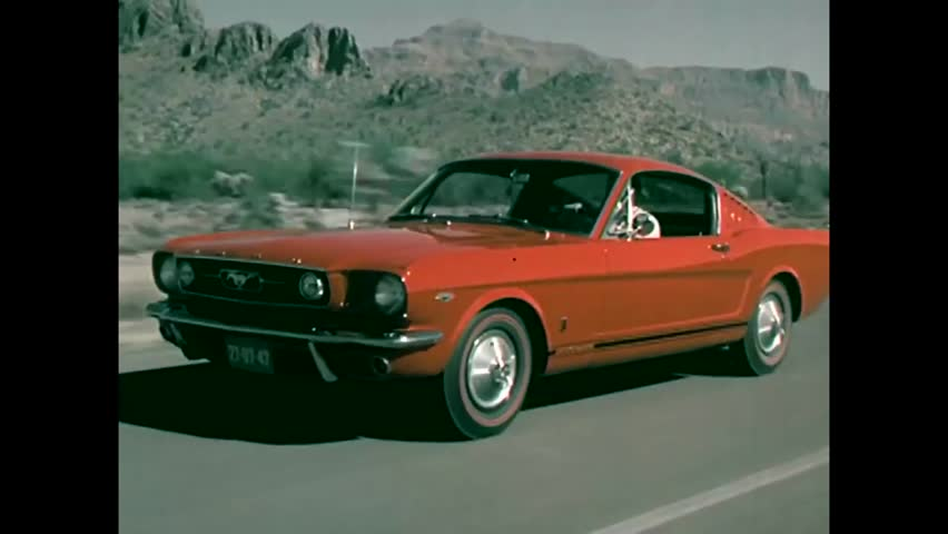 CIRCA 1965 - A Corvette is proven to out-perform a Ford Mustang as a sports car in several ways.